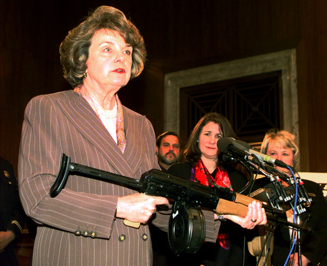 2009 Press Conference of Diane Feinstein (D-CA) on gun safety with her finger on the trigger.