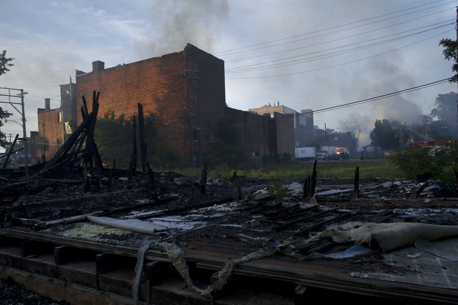 Scene of fire where vacant building burnt to the ground in declining Detroit neighborhood in 2012. Caption/ Image credit: Aaron Lee Fineman - VWPics/Newscom (source: Forbes)