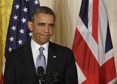 Reuters/Reuters - U.S. President Barack Obama reacts after answering questions about the attack on the U.S. embassy in Benghazi, Libya, during a joint news conference with Britain's Prime Minister David Cameron (Caption/ Photo credit: Reuters)