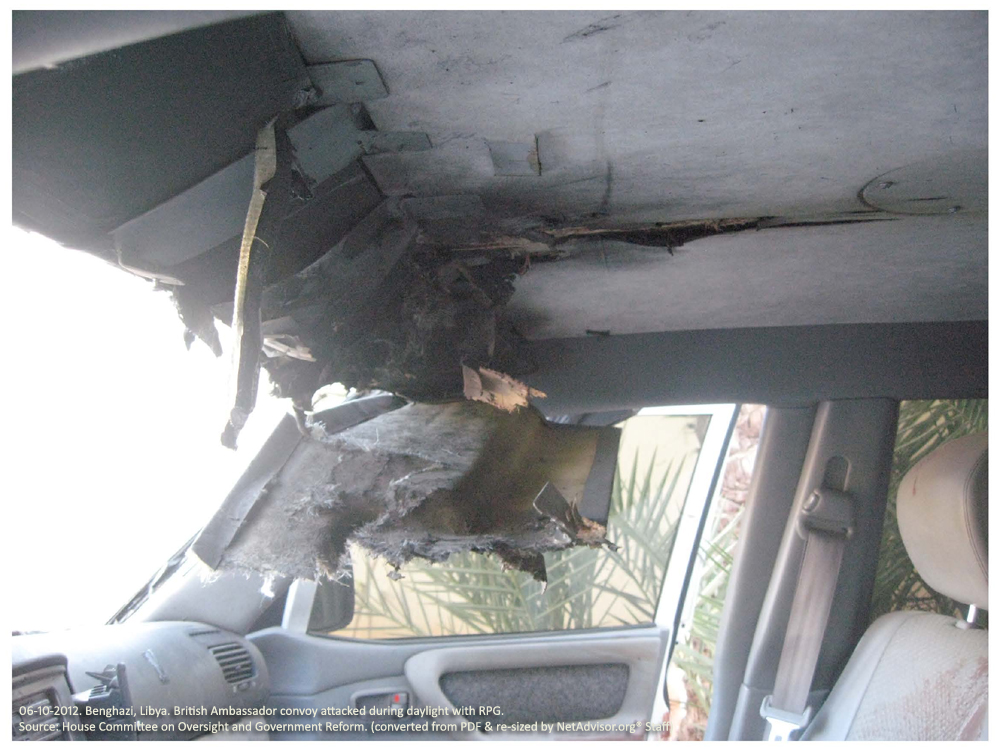 Photo #4: Benghazi, Libya. Two-car convoy carrying the British Ambassador to Libya from a conference on reforming Libyan military law was attacked in broad daylight by a militant with an RPG.