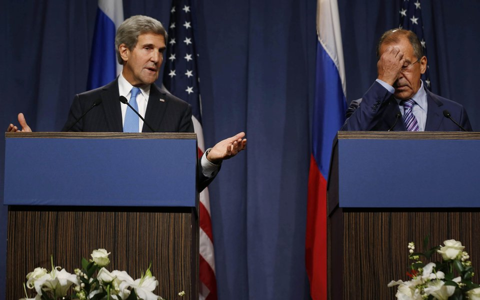09-12-2013. Left to right: U.S. Secretary of State John Kerry (D-MA) with Russia's Foreign Minister Sergey Lavrov  at a press conference in Geneva, Switzerland. The two discussed a potential resolution to how to get rid of Syria's chemical weapons (Photo Credit: AFP/ Philippe Desmazes).