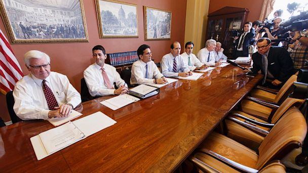 Republicans wait at a table for Democrats to show up to discuss the goverment shutdown. No Democrats bothered to show. Democrats have falsely blamed Republicans & the Tea Party for the shutdown. Dems are unwilling to even have a conversation about it. (Photo Credit: J. Scott Applewhite/AP)