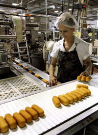 A worker in Schiller Park, Ill., prepares Twinkies for packaging. Caption credit: science.howstuffworks.com. Photo Credit: Tim Boyle/Getty Images.