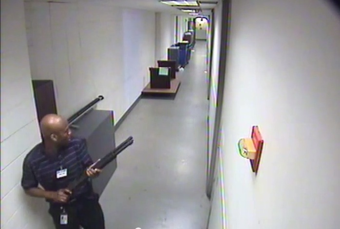 CCTV footage of Aaron Alexis in building 197 holding a Remington 870 shotgun. --- Source: Wikipedia, United States Department of the Navy (CCTV), United States federal government, Federal Bureau of Investigation
