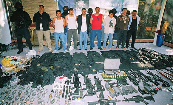 Mexico drug cartel members arrested along with weapons, hand grenades, and body armor with Mexico government's markings (2010 photo uncredited. please advise for credit).