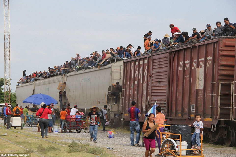 """Central American train known as """"The Beast"""" to due the dangerous ride and thousands of deaths reported traveling through Mexico close to the U.S. border. Drug cartels have reportedly hijacked the train routes charging immigrants $100 or more per person to ride a train they do not own. A 2013 Texas Federal Judge discussed the robbery's, assaults, rapes, murders, and kidnapping that occur from human trafficking to the U.S. (Photo Credit: 2014 AFP/Getty.)"""