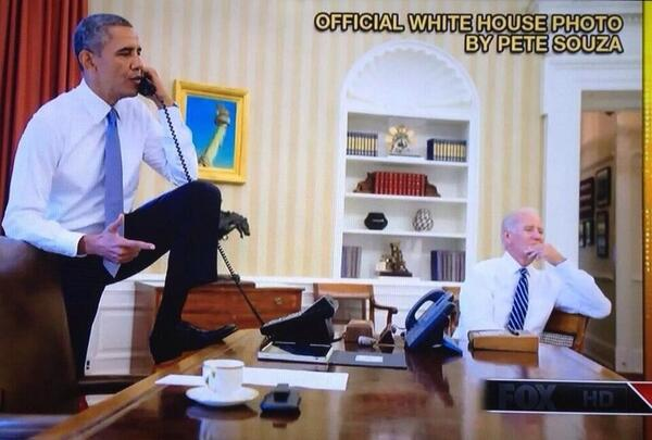 President Obama in the Oval Office in this controversial 'foot on Presidential desk' photo.  Image credit: WH.gov