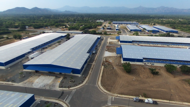 Clinton Foundation industrial park in Haiti is supported by South Korean business interests with ties to the Clinton Foundation. The park failed to provide some additional 55,000 jobs as promised. Workers apparently receive low wages (Image Credit: Miami Herald).